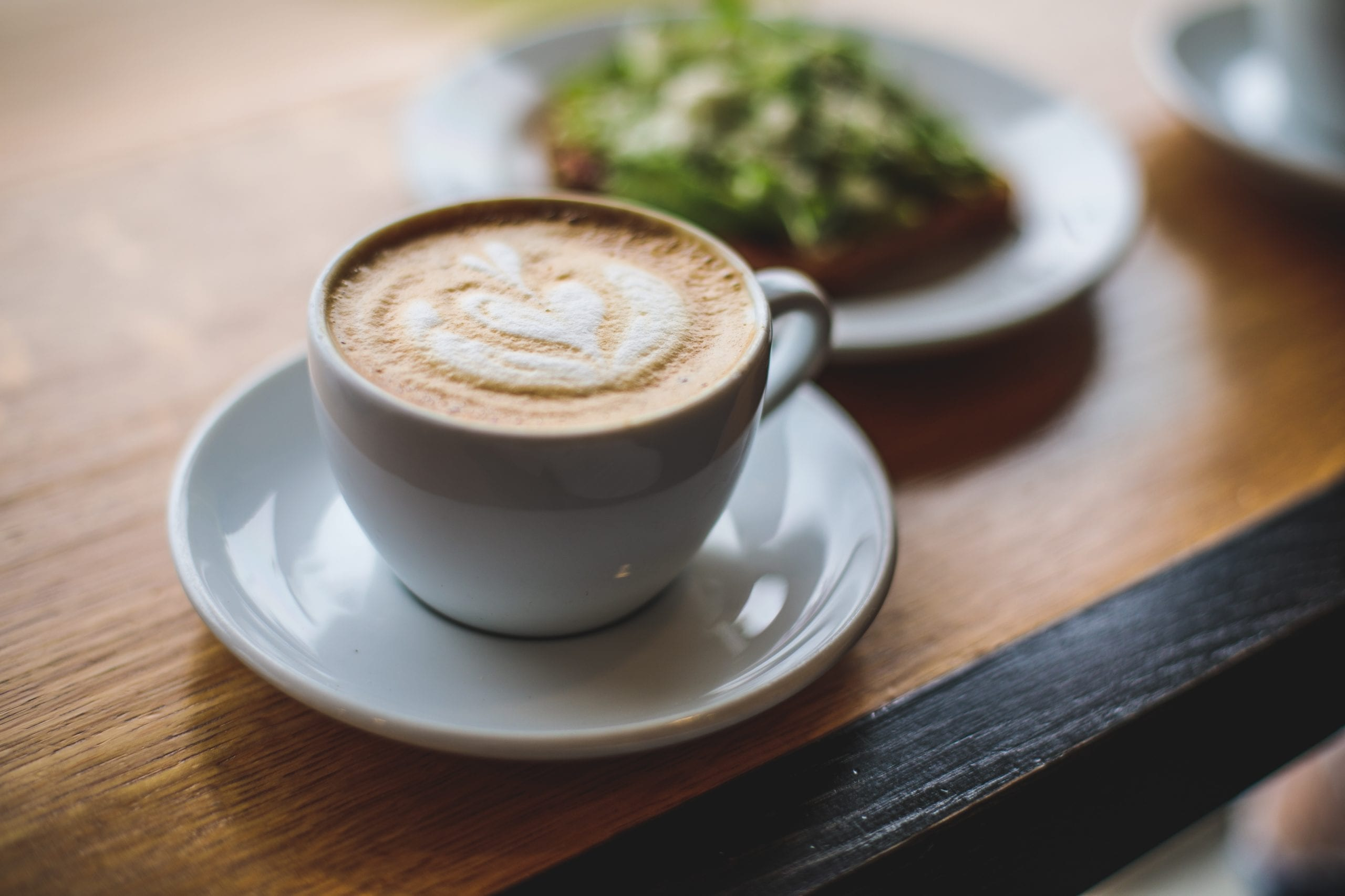 Cappuccino siting on a plate on a table